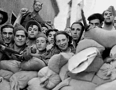 SPANISH CIVIL WAR: TOLEDO.  Lawyer and Radical Socialist deputy Victoria Kent (center) with Republican (Loyalist) troops behind a barricade in front of the Alcazar palace in Toledo, Spain, during the Spanish Civil War, 1936-39.